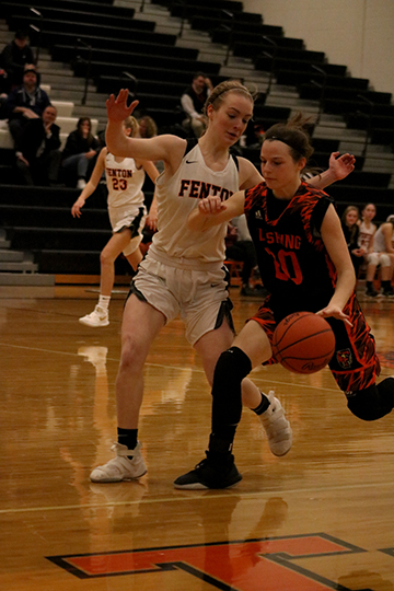Guarding her opponent, senior Lauren Murphy attempts to block the ball. The Fenton Girls Varsity team beat the Flushing Raiders to secure the Metro League title.