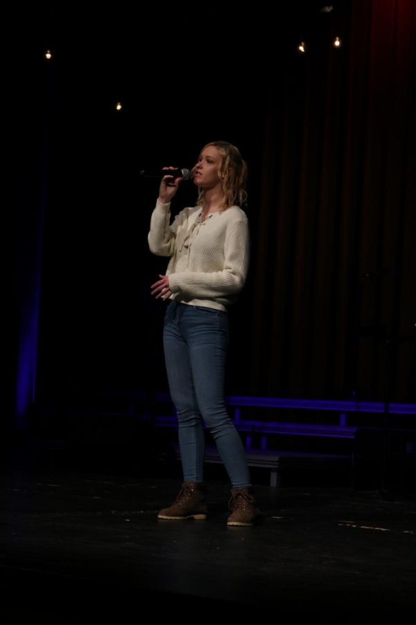 As she works with choir director Brad Wright, senior Taeber Engelhart practices her senior solo for the Ambassadors Concert. Throughout the year, each senior sang a song of their choice at their concerts.