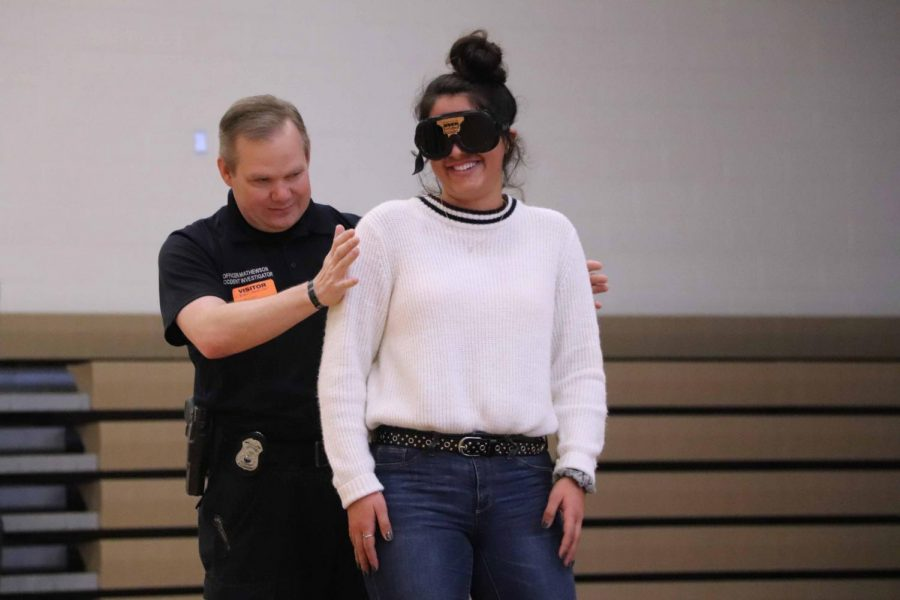In Mr. Sullivan's forensic class, the students are giving a pair of goggle to see what it drinking alcohol will do to their visions. Senior Delaney Miesh volunteered during the experiment.