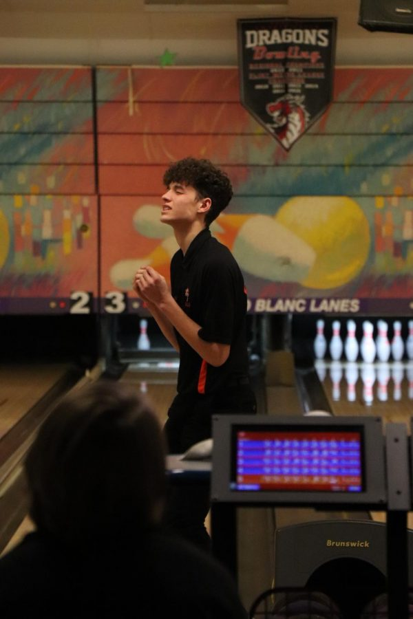 Hoping for the last pin to fall, sophomore Max Guerra turns around and gets ready for his next turn. The boys bowling team played in a tournament against several different schools.