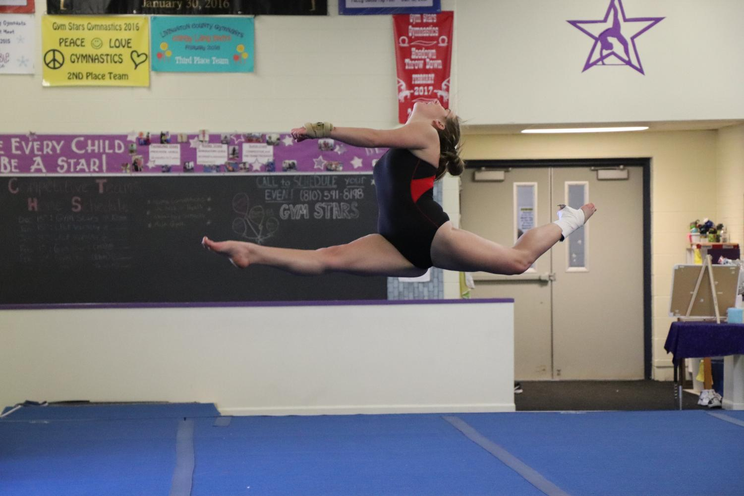 With regionals fastly approaching, the Fenton/Linden gymnastics team has been practicing, making sure every detail is perfect. Sophomore Emma Jump leaps during her floor routine while her teammates cheers her on from the side. Regionals is being held on Saturday March 2 in Grand Ledge.