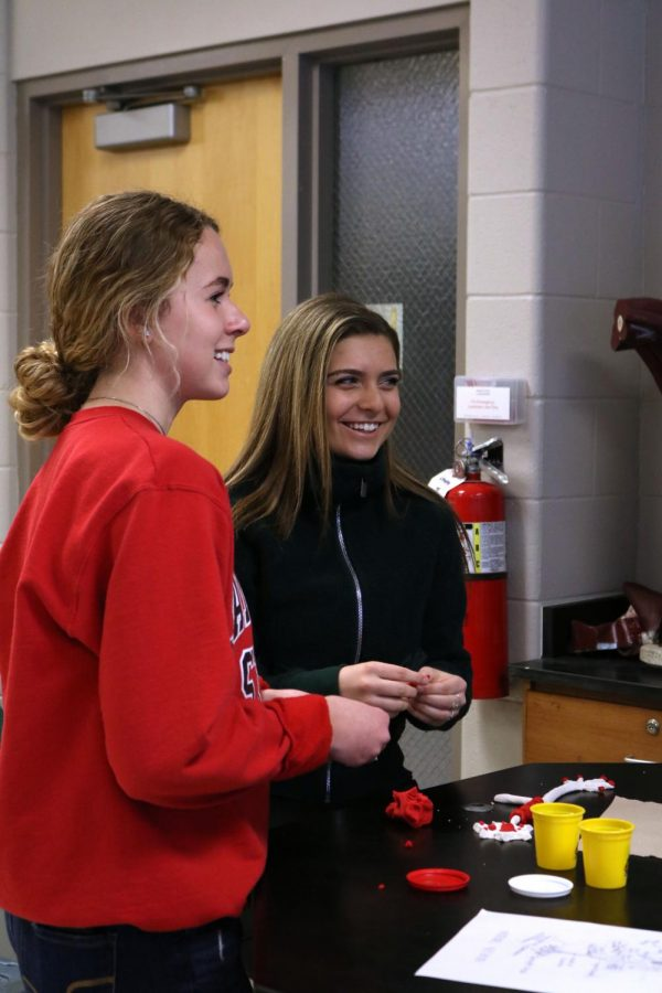 While learning the parts of a neuron, juniors Maria Ebert and Audrey Weir laugh along with juniors Lauren Bossenberger and Julia Adams (not pictured).  The anatomy classes created neurons from play-dough as a way to learn all the parts of a neuron.