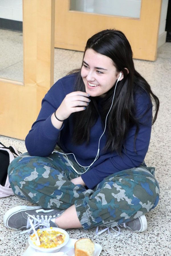 As she laughs at a friends comment, junior Audrey Castel enjoys her lunch during third segment. On Feb. 27, the cafeteria served the Tiger Bowl for all lunches, a blend of corn, chicken, mashed potatoes, and gravy.