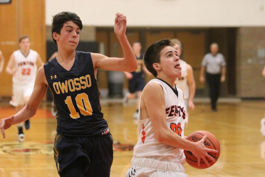 Aiming for the hoop, sophomore Gavin Shepherd scores for the Fenton High JV Boys basketball team. Fenton High won 72-41.