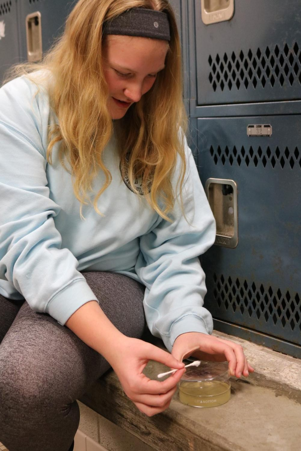 During Biology class,  junior Jillian McVey and her group take a bacteria swab from the gym locker room. Biology teacher Matthew Sullivan's classes took samples from around the school to learn about bacteria.