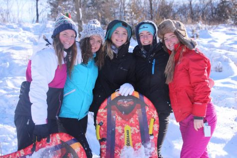 Juniors (left to right) Julia Adams, Maria Ebert, Brie Sanford, Audrey Weir and Julia Young pose for a photo on a snow day.