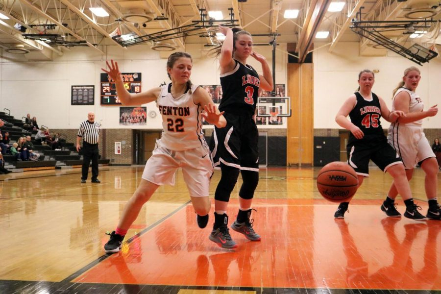 As the ball goes out of bounce, Sophomore Hannah Ludwig makes gestures to say she didn't touch it. Both players acted as if they weren't the last one to touch the ball. The Fenton girls JV basketball team played Linden on Feb. 21.