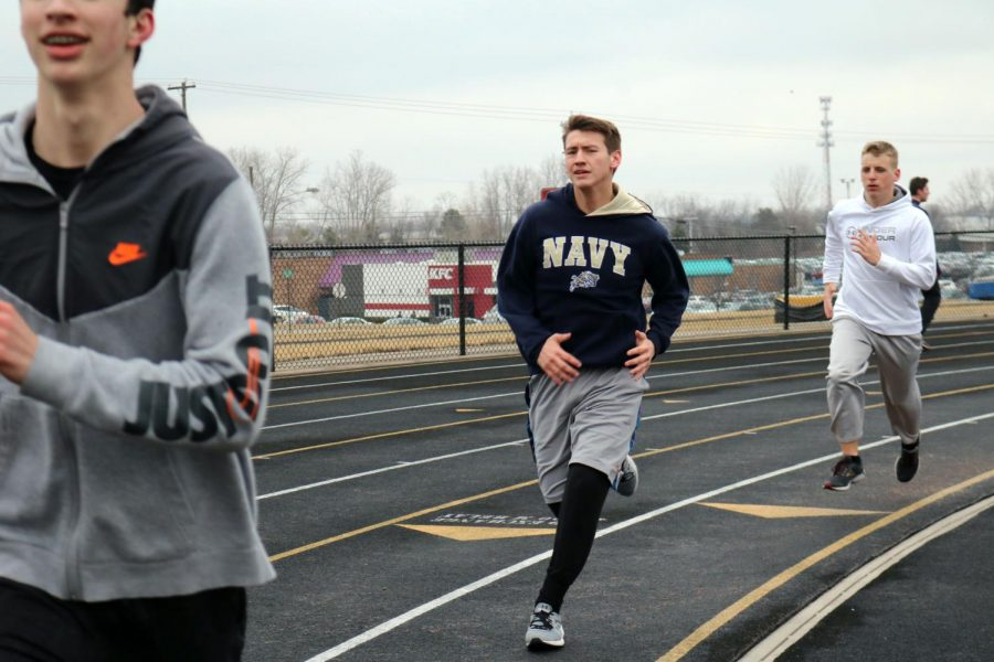 Track season begins and practice commences. Sophomore Brandon Davis with his fellow track team members run sprints on the track at Fenton high school.