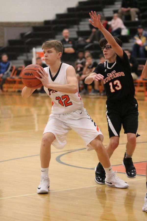 Avoiding an opponent, freshman Austin Pedlar passes the ball to one of his teammates. The Tigers beat the Clio Mustangs in a nail-biting game 30-28.