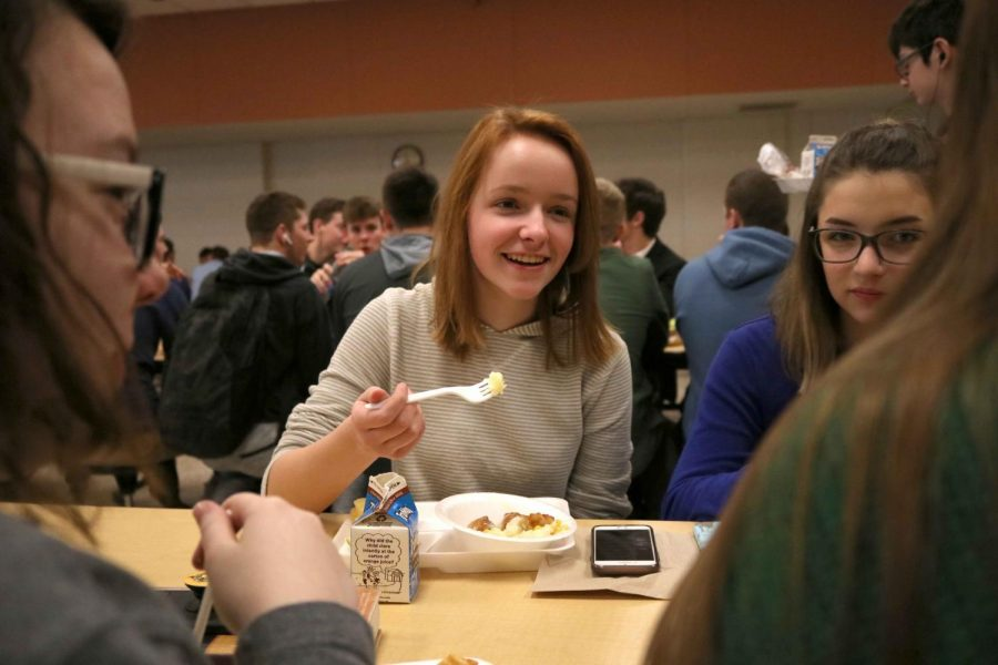 Tiger Bowl on tray, freshman Skye Hodgkin enjoys conversation with her friends during lunch. The tiger bowl is a very popular lunch item that is served every Wednesday.