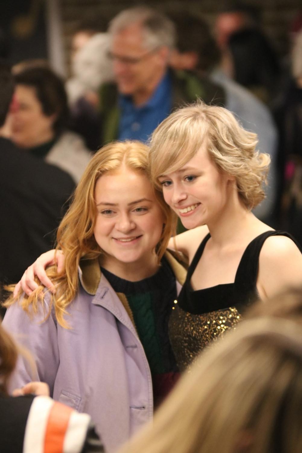 Juniors Zoe Simmerman and Emily Wright pose for a photo after an Ambassadors concert. The Ambassadors performed on Feb. 22 and 23.