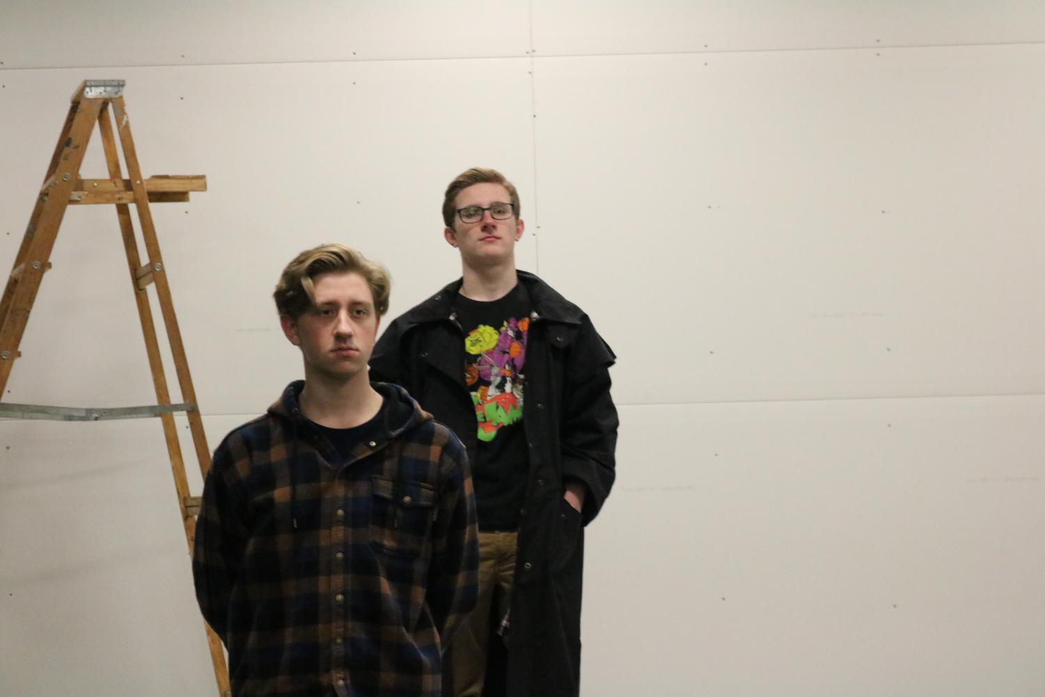 Seniors Justice Fredrick and Joe Bujak practice in the Black Box for their upcoming play: