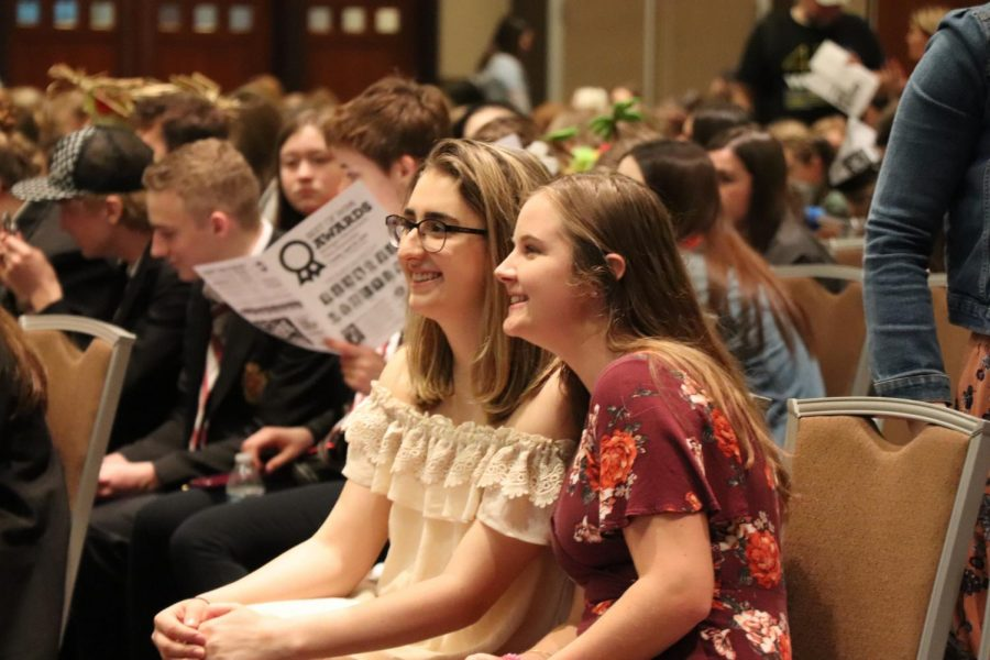 As they wait to accept their awards, seniors Ellie Bennett and Madi Wheeler, smile for the camera. The Fenton Yearbook and Newspaper staff received more than 70 individual awards.