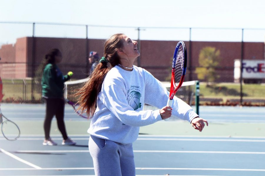 Eyes on the ball, freshman Josie Cherney, holds her racket ready to hit the ball. The JV Tennis Girls' has an upcoming match coming up on Apr. 18.