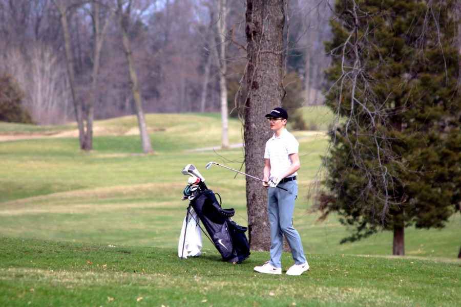 On Coyote Preserve golf course, the JV boys golf team drive their ball to the rest of the green space. Freshman Mitchell Straffon watched his ball go towards the hole as he goes against a hartland opponent.