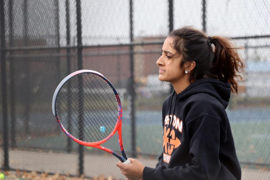 Focused on her coach, sophomore Sarasee Kiran, holds her racket ready to hit the ball. The Varsity Girls' Tennis had a game Apr. 16.