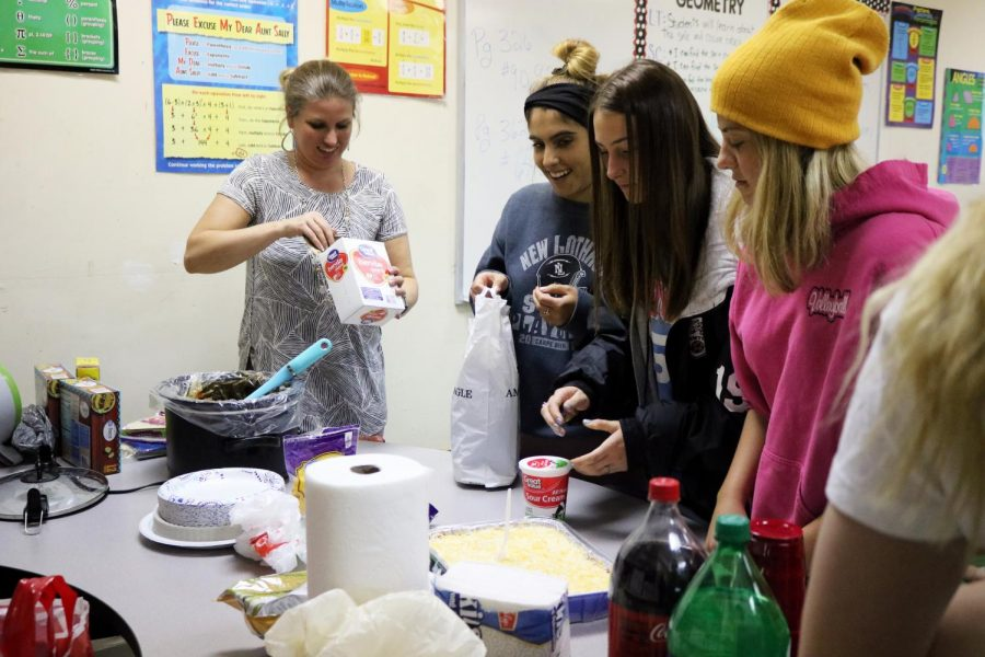 As they set up for their SRT Taco party, juniors Marissa Delecki and Trinity Sawyer, open up supplies that they brought in.  Muzer's SRT enjoys tacos and other snack during the party.