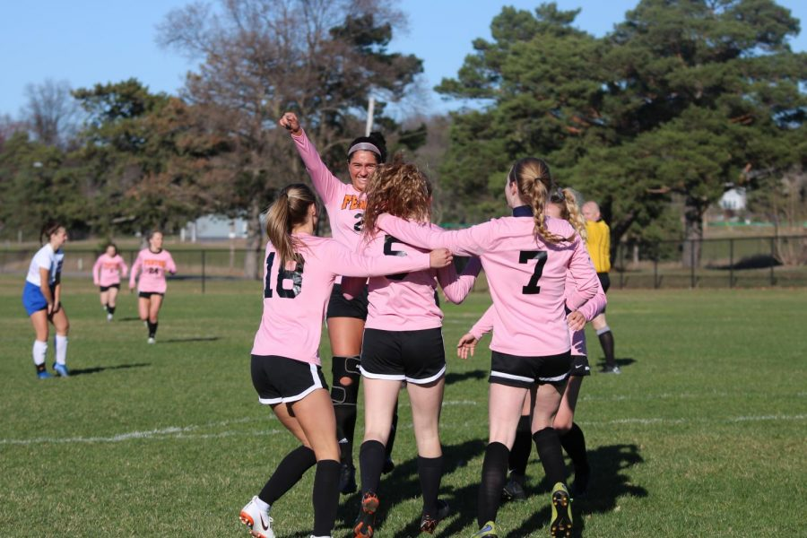 Cheering on her teammate, senior Delaney Miesch pumps her fist in the air in celebration. The girls varsity soccer team won against Brandon on April 15 with a score of 7-1.