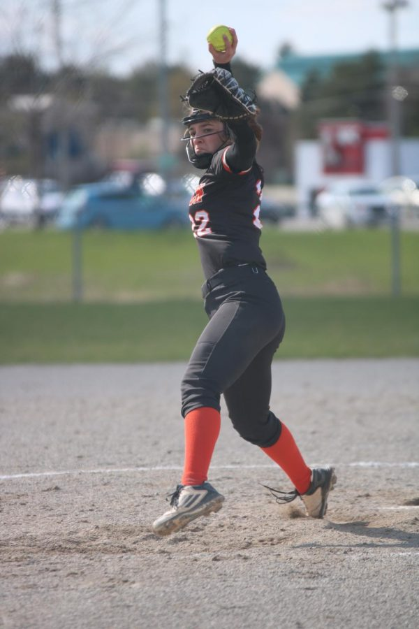 Eyes on her target, junior Abby Skinner pitches the ball. On April 26th, the TIgers crushed the Hartland Eagles 14-3.