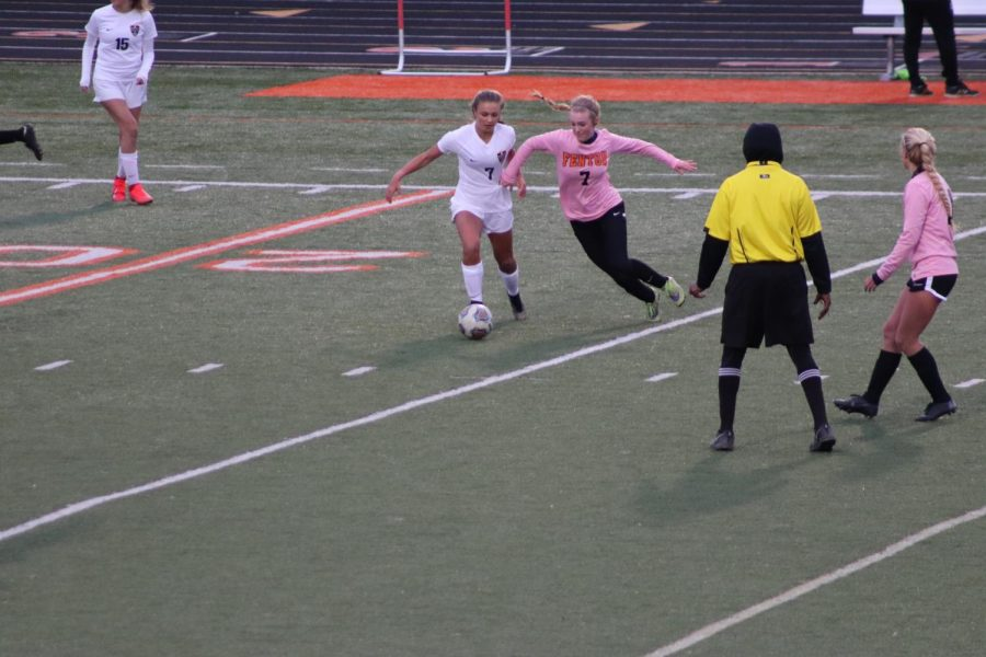Senior Lauren Murphy goes after the ball. The girls varsity soccer team lost against Dwitt with a score of 0-4.