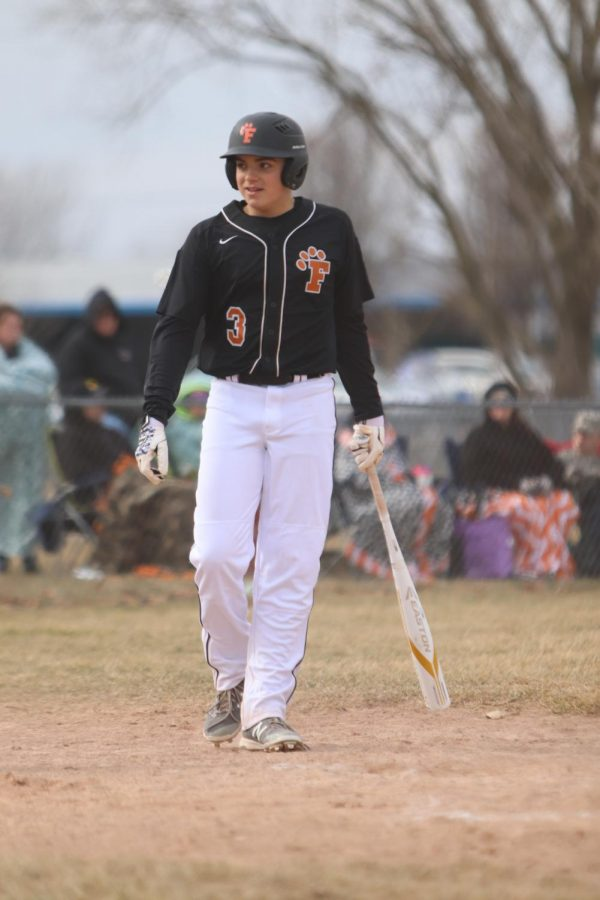 Stepping up to the plate, freshman Seth Logan glances at the umpire. The Tigers fell in a close game 1-3.