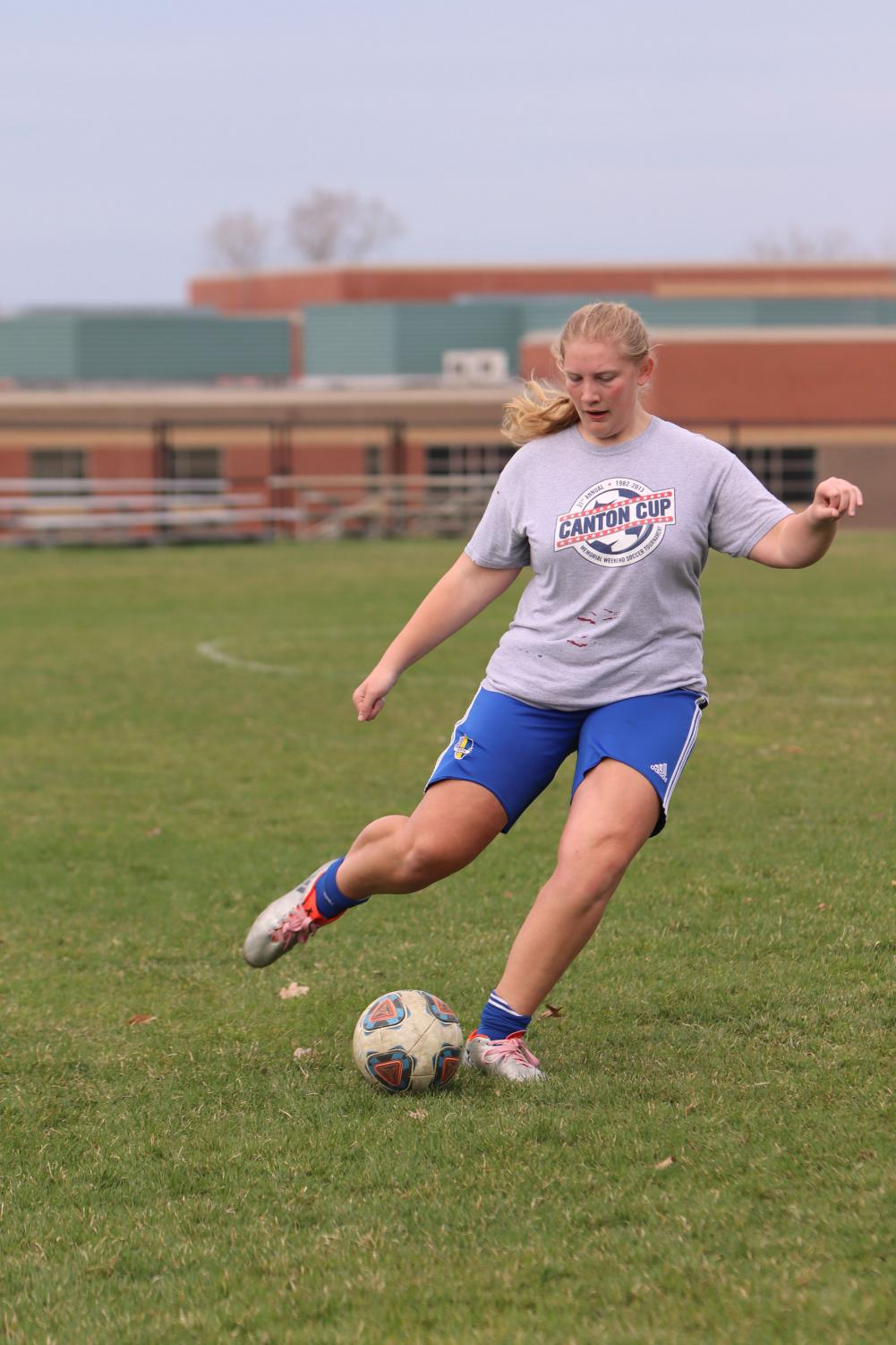 During soccer practice, sophomore Jillian McVey gets into goal shooting position to kick the ball. On April 16, the JV girls soccer team held their daily practice to prepare for upcoming games.
