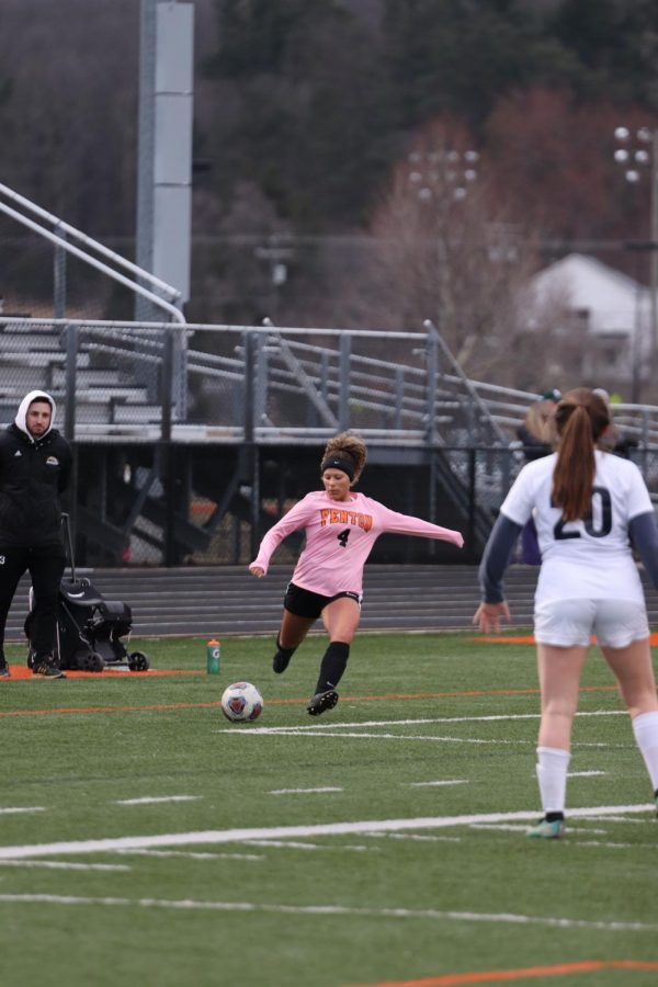 About to kick the ball, senior Kiersten Foor takes a penalty kick. The girls played Dwitt on April 4.