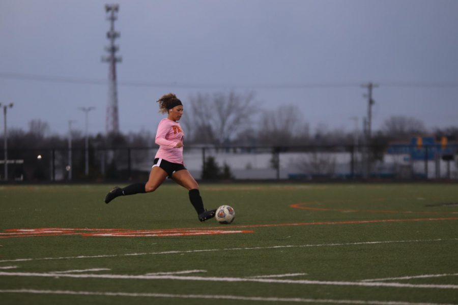 Senior Kirty Foor strikes the ball for a free kick. Their game against Swartz Creek on April 2 ending with a score of 2-0.