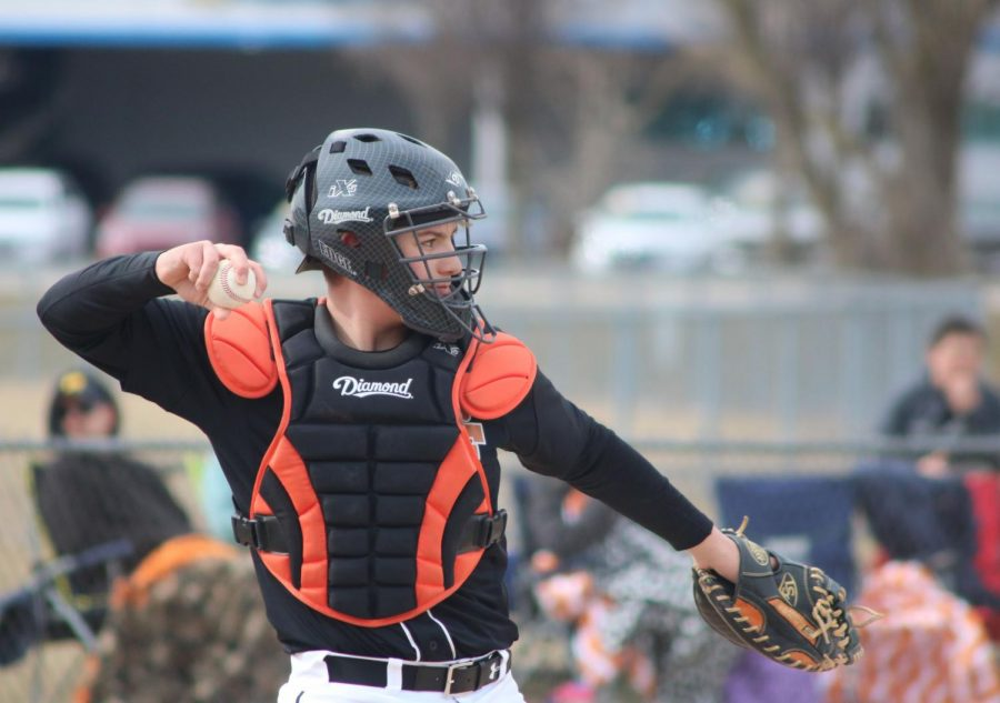 With a baseball in his hand, freshman David McDermott throws it back to Fenton High pictcher. The Fenton freshman boys baseball tied with Saline 3-3.