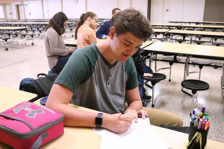 During a Key Club meeting, sophomore Joseph Henley circles the names of students he wants to elect for leadership positions. On April 6, Key Club members gave speeches and voted for their elected peers to be in charge.