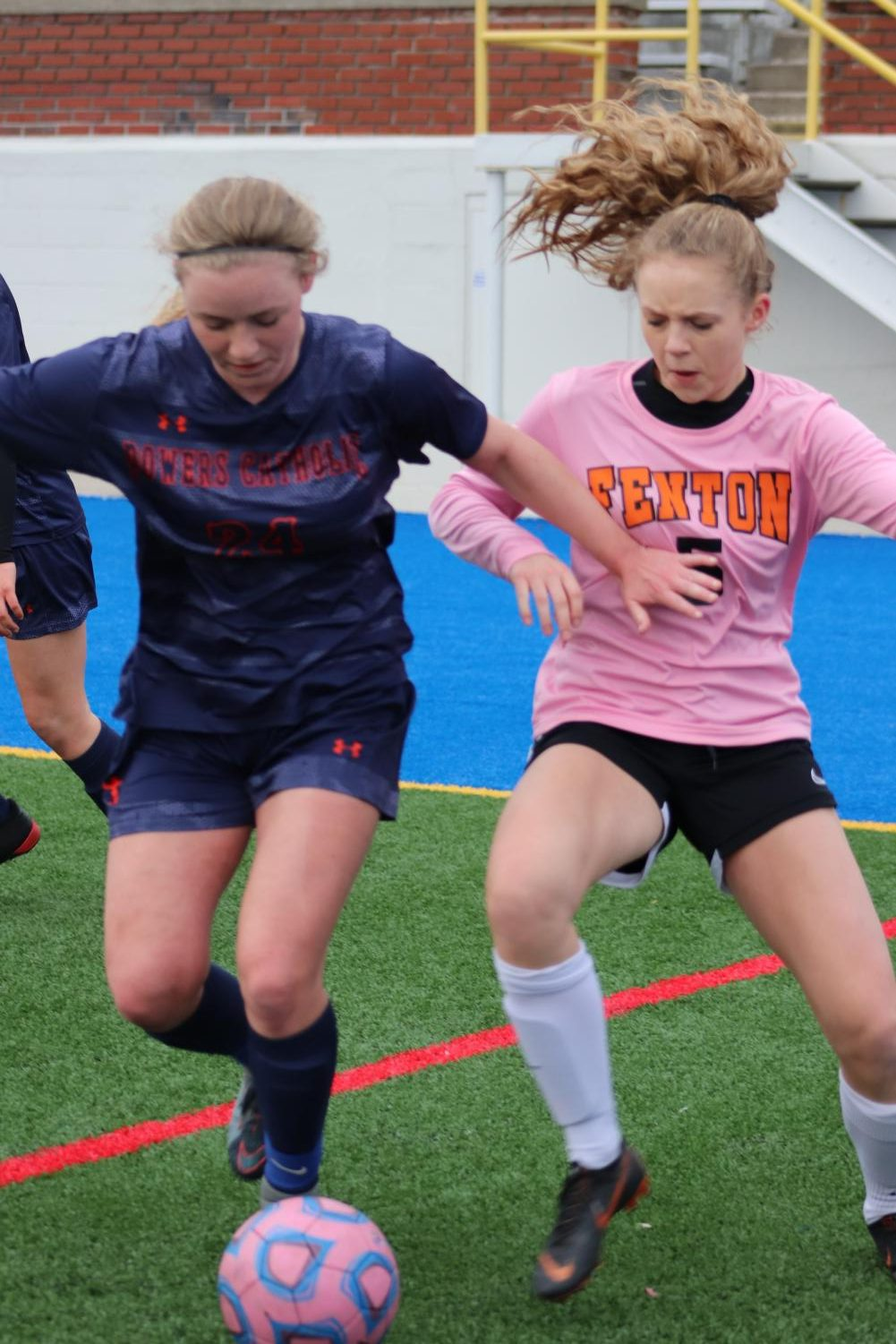 As sophomore Callie Dickens dribbles the ball, a Powers Catholic player tries to steal it. The score ended being 3-1.