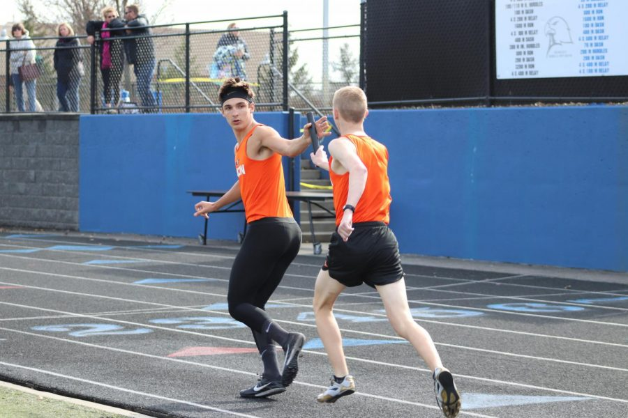 As freshaman Michael Crane hands off the baton to junior Grant Bluthardt for the 4 x 800. The boys team finished 3rd over all.