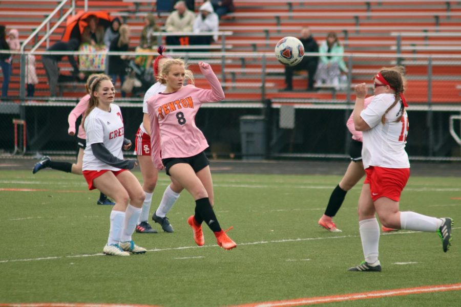 Surrounded by her Swartz Creek opponents, sophomore Abigale Gray prepares to steal the ball from her opponents. The JV girls soccer teams next game is on Apr. 8 against Dexter High School.