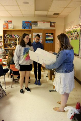 As she says her goodbyes, freshman Samantha Megdanoff gives her student teacher a card. The freshman advanced literature class threw a party to celebrate the semester they had with Rebecca Turri.