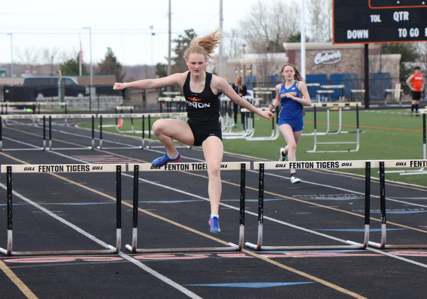 Hopping over the hurdles, junior Stasia Campbell finishes in 2nd place. Campbell competed in the 100 yard hurdles against Linden and Owosso High.