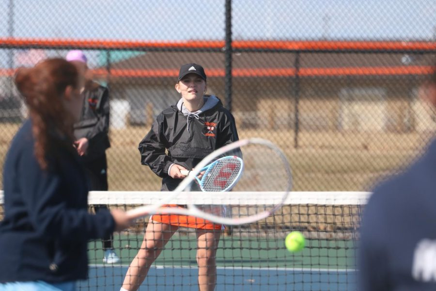 While playing her first meet of the season, junior Katlin Gruber stands ready, watching her opponent. The Fenton girls varsity tennis fell to powers 6-2.
