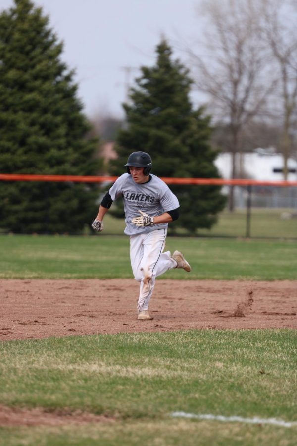 During practice on Apr. 17, senior Brock Henson runs for third base.  The varsity baseball team plays against Flushing on Apr. 22 at home.