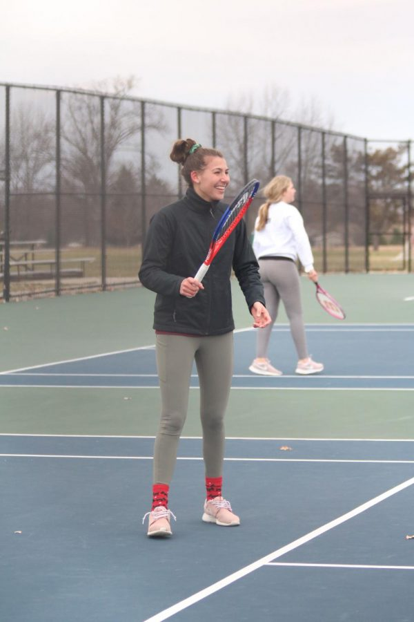 Hitting the tennis ball to her opponent, freshman Josie Cherney scores for the Fenton high JV girls tennis. They played against South Lyon on Apr. 10.