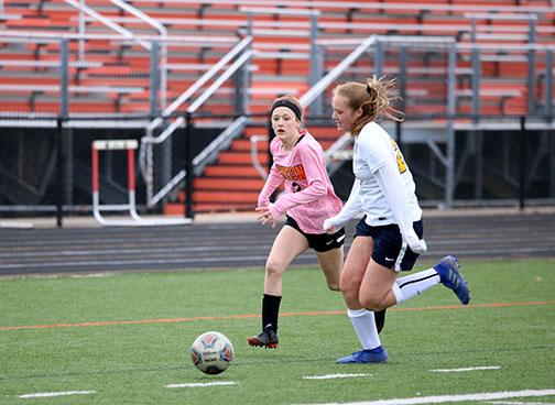 As she runs toward the goal, sophomore Kiersten Hyder attempts to score for her team. The girls JV soccer team beat the Dewitt Panthers, 2-0.