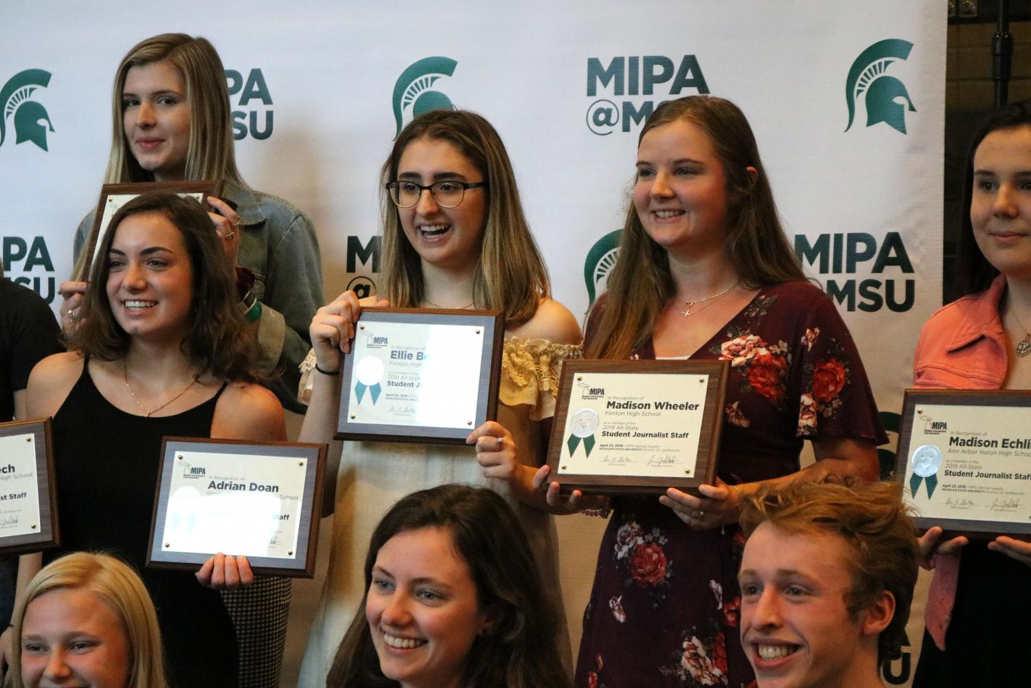 Seniors Ellie Bennett and Madison Wheeler pose for a group photo of MIPA awards winners. On April 23, yearbook and newspaper staff members went to the annual MIPA awards ceremony to celebrate their accomplishments.