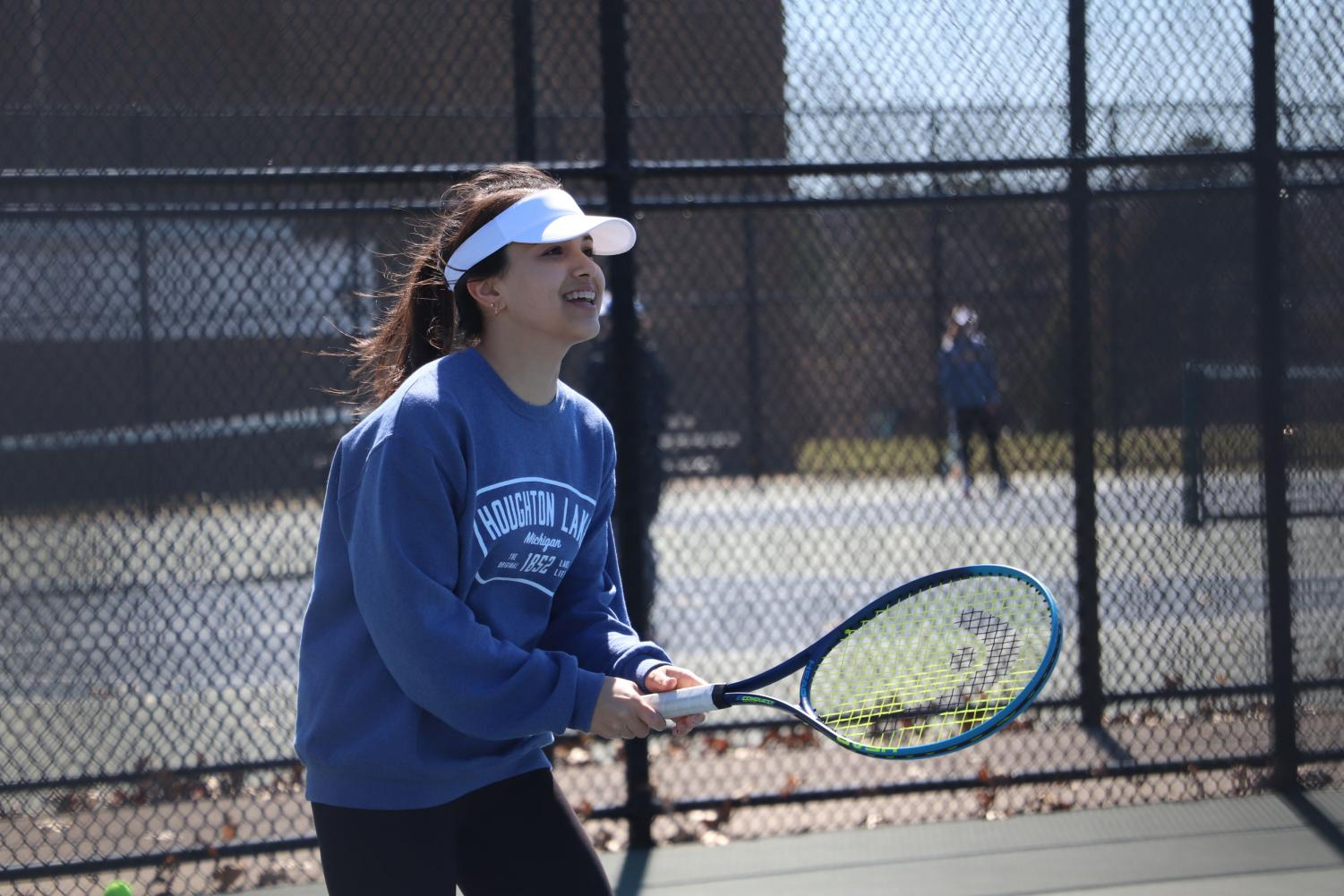 During JV tennis practice, freshman Alyssa Andrews plays