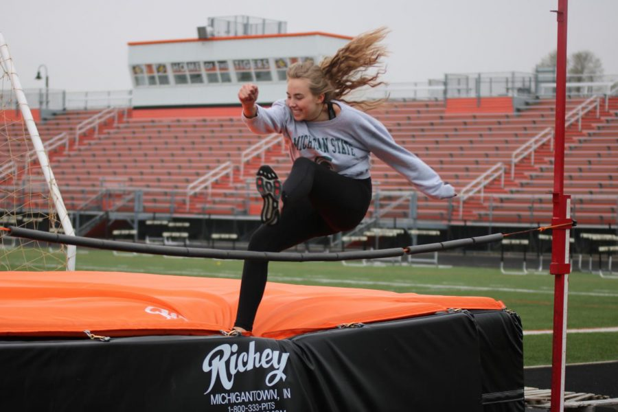 While practicing for high jump, junior Ellie Koester performs a
