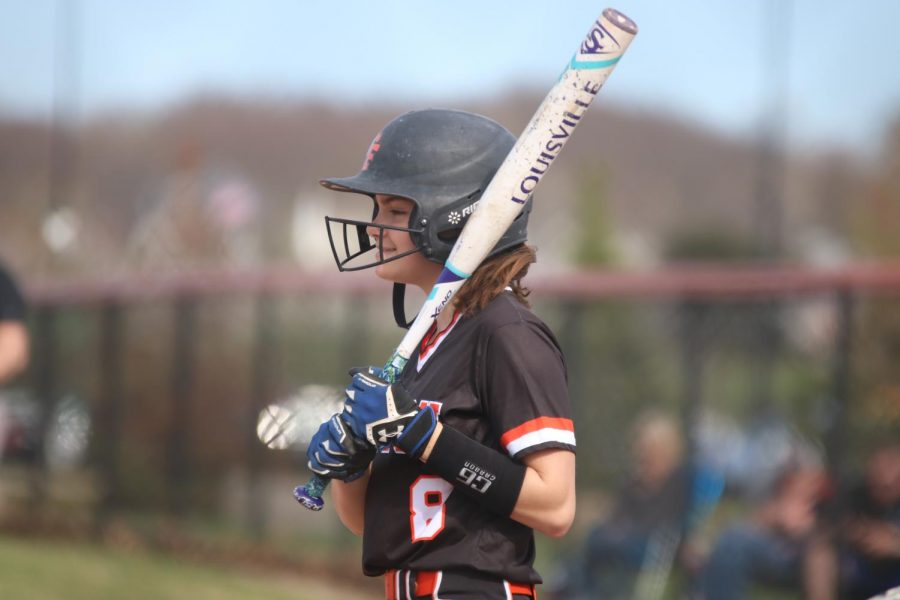 Getting to bat, sophomore Chloe Lefever looks at her teammates for reassurance. The girls varsity softball team beat Flushing on April 22 with a score of 13-3.