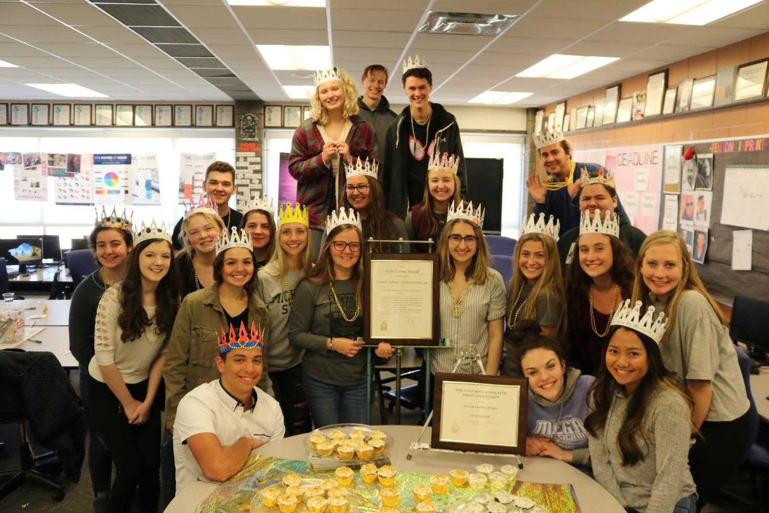 Members of the Fenton InPrint staff pose with the Gold Crown award.