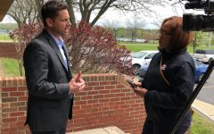 Superintendent Adam Hartley speaks with a reporter on Friday, May 17.