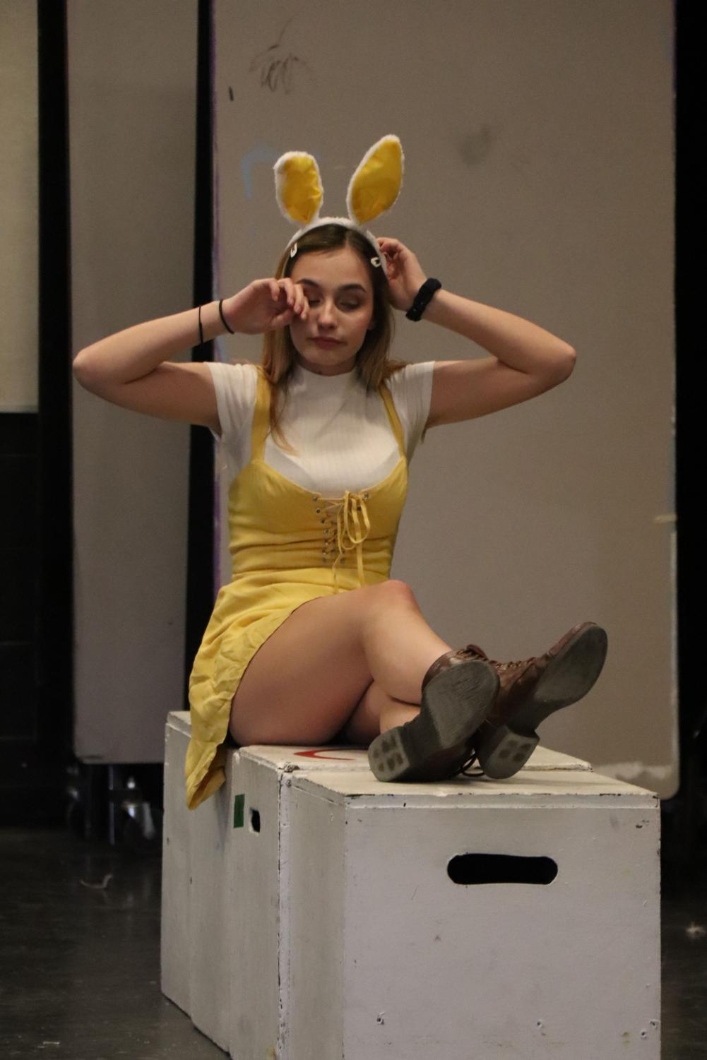 Acting as Rabbit from Winnie the Pooh, sophomore Emily Hamlin stretches during a scene of waking up. On May 10, Drama Day was held throughout the school day were all classes performed a prepared skit.