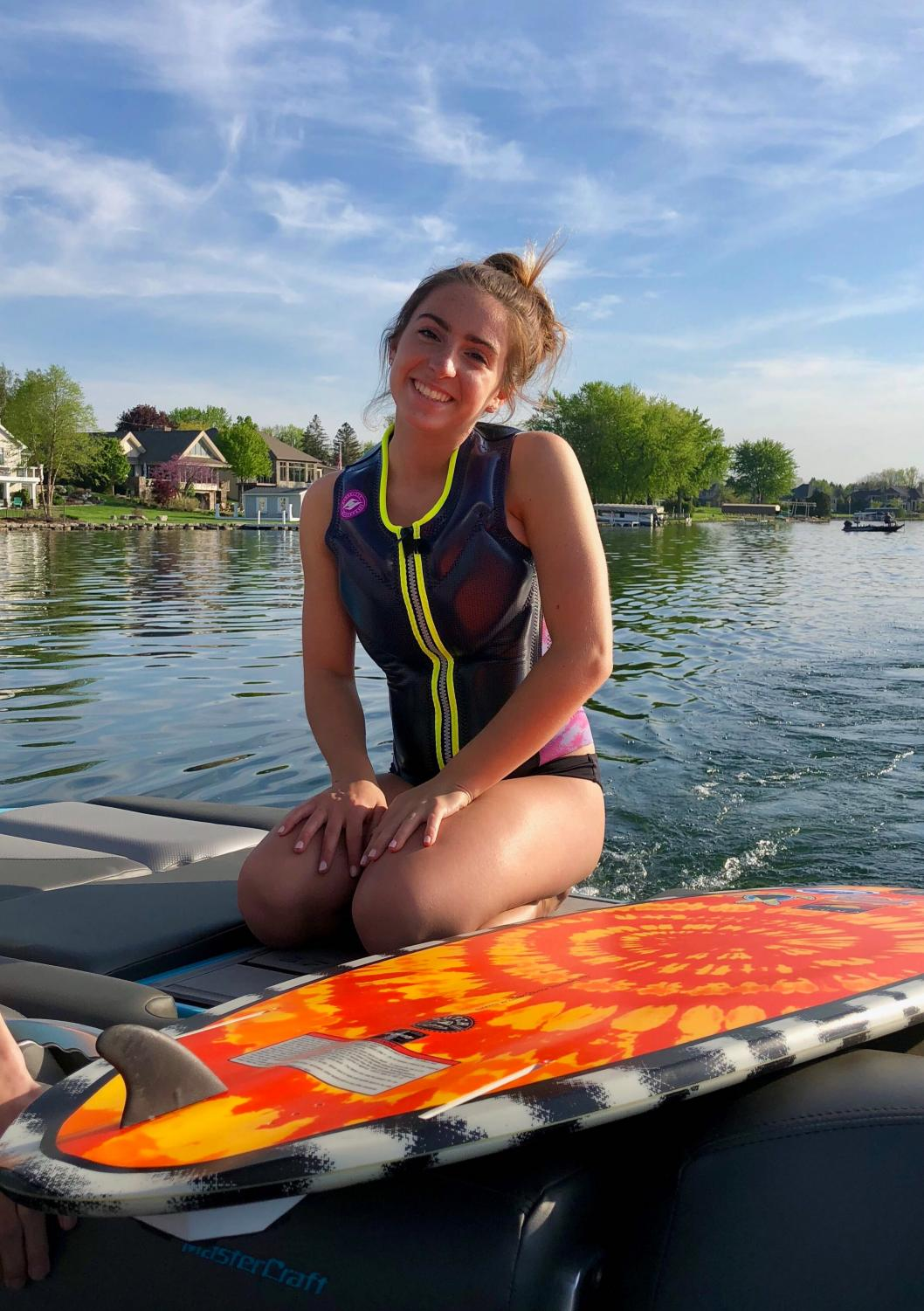 Senior+Julia+Stocker%3A+%E2%80%9CI%E2%80%99ve+been+surfing+for+three+summers.+I+got+into+it+when+we+got+our+boat+that+had+ballast+tanks+for+surfing%2C+and+I+took+one+lesson+and+immediately+fell+in+love+with+it.+It%E2%80%99s+so+fun+to+be+behind+the+boat+doing+tricks+and+listening+to+music.+There%E2%80%99s+nothing+to+dislike+about+it%3B+I+just+love+everything+about+it.%E2%80%9D