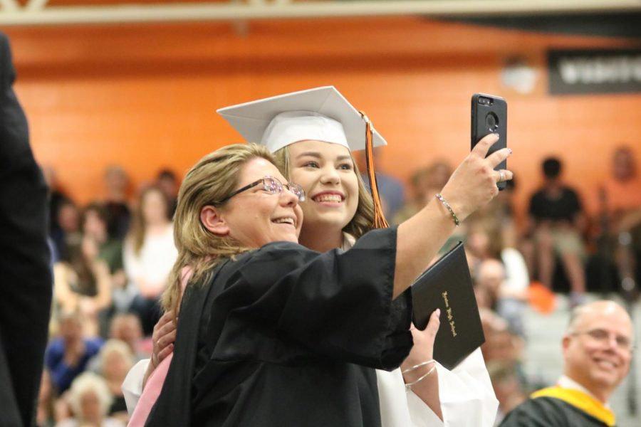 Taking a selfie with her mom, senior Emily Hayes smiles for the camera as she accepts her diploma. The seniors' Commencement Ceremony took place on June  2.