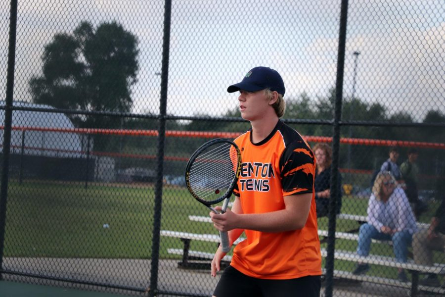 Waiting for the ball, senior Jack Gundry stands ready to hit it back to his opponent. The Varsity Boys' tennis team versed against Owosso on Sept. 17.