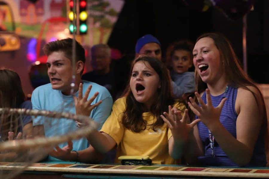 While at the Applefest freshmen Abby Logan, Mathew Allor, and Adrienne Staib get upset after losing all of their quarters. This year's annual Applefest was held from Sept 12-15 at St. John Catholic Elementary School.
